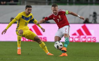 Shomko Dmitry of Kazakhstan competes for the ball with Balázs Dzsudzsák of Hungary during friendly football match between Hungary and Kazakhstan at Groupama Arena on March 23, 2018 in Budapest, Hungary.