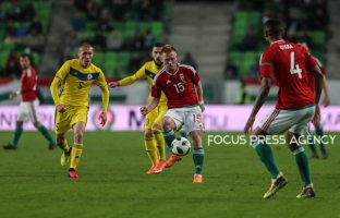 Laszlo Kleinhesiler of Hungary passes the ball to Otigba Kenneth of Hungary during friendly football match between Hungary and Kazakhstan at Groupama Arena on March 23, 2018 in Budapest, Hungary.