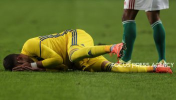 Khizhnichenko Sergey of Kazakhstan lies on the ground during friendly football match between Hungary and Kazakhstan at Groupama Arena on March 23, 2018 in Budapest, Hungary.