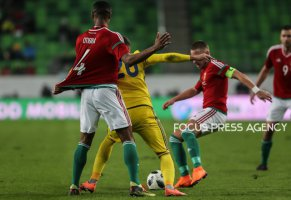 Khizhnichenko Sergey of Kazakhstan competes for the ball with Otigba Kenneth of Hungary during friendly football match between Hungary and Kazakhstan at Groupama Arena on March 23, 2018 in Budapest, Hungary.