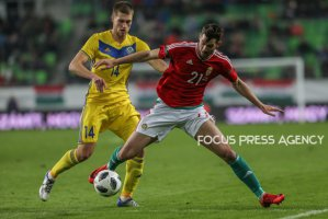 Murtazayev Roman of Kazakhstan competes for the ball with Barnabas Bese of Hungary during friendly football match between Hungary and Kazakhstan at Groupama Arena on March 23, 2018 in Budapest, Hungary.