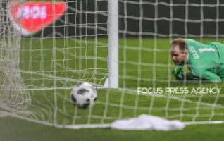Hungarian gool-keeper Peter Gulácsi watches the second kazakh goal during friendly football match between Hungary and Kazakhstan at Groupama Arena on March 23, 2018 in Budapest, Hungary.