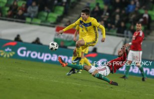 Zainutdinov Baktyor of Kazakhstan competes for the ball with Attila Fiola of Hungary during friendly football match between Hungary and Kazakhstan at Groupama Arena on March 23, 2018 in Budapest, Hungary.