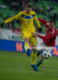Malyy Sergey of Kazakhstan competes for the ball with Nikolics Nemanja of Hungary during friendly football match between Hungary and Kazakhstan at Groupama Arena on March 23, 2018 in Budapest, Hungary.