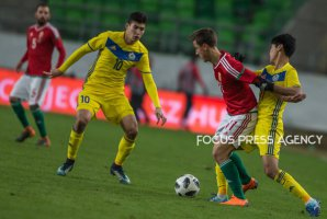 Zainutdinov Baktyor of Kazakhstan competes for the ball with Krisztian Németh of Hungary during friendly football match between Hungary and Kazakhstan at Groupama Arena on March 23, 2018 in Budapest, Hungary.