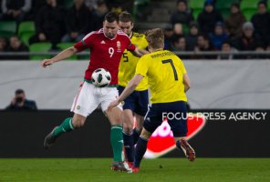 Adam Szalai of Hungary competes for the ball with Stuart Armstrong of Scotland during the friendly match between Hungary and Scotland at Groupama Arena on March 27, 2018 in Budapest, Hungary.