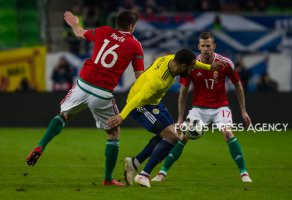 Adam Pintér of Hungary competes for the ball with Matt Phillips of Scotland during the friendly match between Hungary and Scotland at Groupama Arena on March 27, 2018 in Budapest, Hungary.