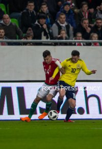 Szilveszter Hangya of Hungary competes for the ball with Callum McGregor of Scotland during the friendly match between Hungary and Scotland at Groupama Arena on March 27, 2018 in Budapest, Hungary.