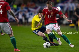 Andrew Robertson of Scotland competes for the ball with Roland Varga of Hungary during the friendly match between Hungary and Scotland at Groupama Arena on March 27, 2018 in Budapest, Hungary.