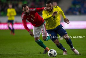 Attila Fiola of Hungary competes for the ball with Matt Philips of Scotland during the friendly match between Hungary and Scotland at Groupama Arena on March 27, 2018 in Budapest, Hungary.