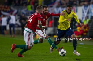Gergo Lovrencsics of Hungary competes for the ball with Charlie Mulgrew of Scotland during the friendly match between Hungary and Scotland at Groupama Arena on March 27, 2018 in Budapest, Hungary.