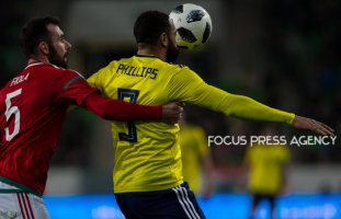 Attila Fiola of Hungary competes for the ball with Matt Phillips of Scotland during the friendly match between Hungary and Scotland at Groupama Arena on March 27, 2018 in Budapest, Hungary.