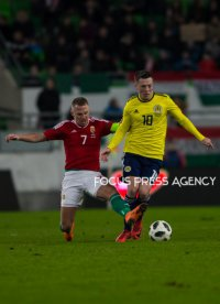 Balazs Dzsudzsák of Hungary competes for the ball with Callum McGregor of Scotland during the friendly match between Hungary and Scotland at Groupama Arena on March 27, 2018 in Budapest, Hungary.