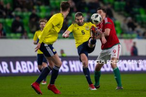 Charlie Mulgrew of Scotland competes for the ball with Adam Szalai of Hungary during the friendly match between Hungary and Scotland at Groupama Arena on March 27, 2018 in Budapest, Hungary.