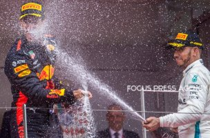 The winner Daniel Ricciardo of Australia and Red Bull Racing Team driver and the third Lewis Hamilton Mercedes Team driver celebrate on the podium after the race at Grand Prix de Monaco on May 27, 2018 in Monte Carlo, Monaco.