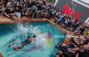 The winner Daniel Ricciardo of Australia and Red Bull Racing Team driver jumps into the water after the race at Grand Prix de Monaco on May 27, 2018 in Monte Carlo, Monaco.
