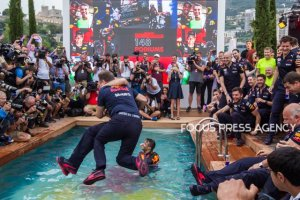 Adrien Newey and Christian Horner jump into the water after Daniel Ricciardo won the race at Grand Prix de Monaco on May 27, 2018 in Monte Carlo, Monaco.