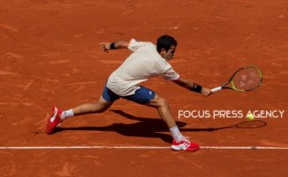 Jaume Munar of Spain returns the ball to Novak Djokovic of Serbia during the second round at Roland Garros Grand Slam Tournament - Day 4 on May 30, 2018 in Paris, France.