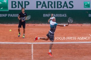 Lukasz Kubot of Poland and Marcelo Melo of Brazil returns the ball to Márton Fucsovics of Hungary and Marco Cecchinato of Italy during the second round at Roland Garros Grand Slam Tournament - Day 4 on May 30, 2018 in Paris, France.