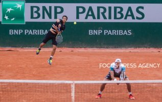 Lukasz Kubot of Poland and Marcelo Melo of Brazil serves against Márton Fucsovics of Hungary and Marco Cecchinato of Italy during the second round at Roland Garros Grand Slam Tournament - Day 4 on May 30, 2018 in Paris, France.