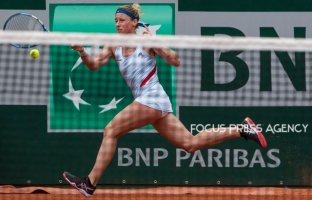 Pauline Parmentier of France returns the ball to Caroline Wozniacki of Denmark during the third round at Roland Garros Grand Slam Tournament - Day 6 on June 01, 2018 in Paris, France.