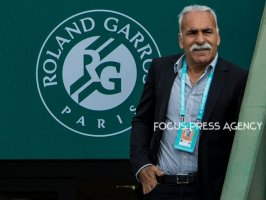 Mansour Bahrami retired professional tennis player watching the match of Caroline Wozniacki of Denmark and Pauline Parmentier of France during the third round at Roland Garros Grand Slam Tournament - Day 6 on June 01, 2018 in Paris, France.