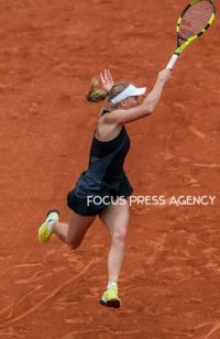 Caroline Wozniacki of Denmark returns the ball to Pauline Parmentier of France during the third round at Roland Garros Grand Slam Tournament - Day 6 on June 01, 2018 in Paris, France.