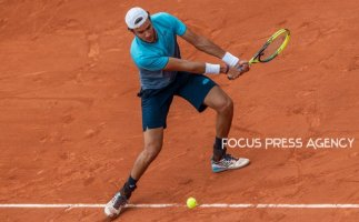 Matteo Berrettini of Italy returns the ball to Dominic Thiem of Austria during the third round at Roland Garros Grand Slam Tournament - Day 6 on June 01, 2018 in Paris, France.