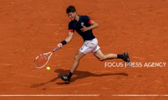 Dominic Thiem of Austria returns the ball to Kei Nishikori of Japan during the fourth round at Roland Garros Grand Slam Tournament - Day 8 on June 03, 2018 in Paris, France.