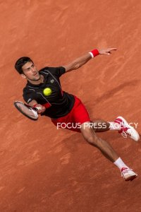 Novak Djokovic of Serbia returns the ball to Fernando Verdasco of Spain during the fourth round at Roland Garros Grand Slam Tournament - Day 8 on June 03, 2018 in Paris, France.