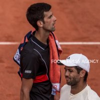 Novak Djokovic of Serbia and Fernando Verdasco of Spain during the fourth round at Roland Garros Grand Slam Tournament - Day 8 on June 03, 2018 in Paris, France.