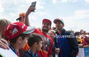 Pierre Gasly of France and Torro Rosso Team driver gives autograph before the qualification at Austrian Formula One Grand Prix on Jun 30, 2018 in Red Bull Ring, Spielberg, Austria.
