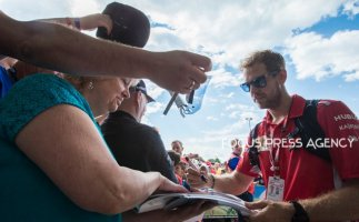 Sebastian Vettel of Germany and Ferrari Team driver gives autogram before the qualification at Austrian Formula One Grand Prix on Jun 30, 2018 in Red Bull Ring, Spielberg, Austria.