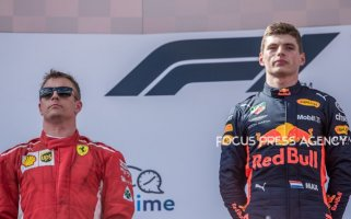 The winners 1st Max Verstappen and 2nd Kimi Raikkonen on the podium after the race at Austrian Formula One Grand Prix on July 01, 2018 in Red Bull Ring, Spielberg, Austria.