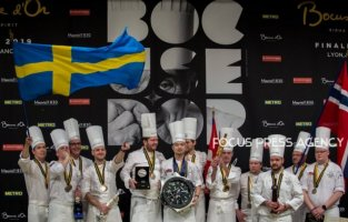 Chef Christian André Pettersen and Team Norway has a 3rd place, Chef Sebastian Gibrand and Team Sweden has a 2nd and the winner Chef Kenneth Toft-Hansen and Team Danemark celebrate on the podium at the Bocuse d'Or Grand Finale on Jan 30, 2019 at Eurexpo in Lyon, France.