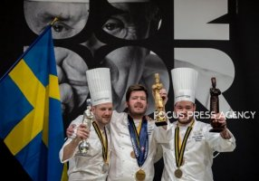 Chef of Norway Christian André Pettersen has a 3rd place, Chef of Sweden Sebastian Gibrand has a 2nd and the winner Chef of Danemark Kenneth Toft-Hansen celebrate on the podium at the Bocuse d'Or Grand Finale on Jan 30, 2019 at Eurexpo in Lyon, France.