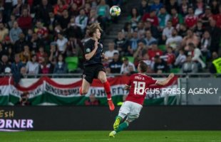 Borna Barisic of Croatia competes for the ball with Dominik Nagy of Hungary during the Hungary and Croatia European Qualifying match at Groupama stadium on March 24, 2019 in Budapest, Hungary.