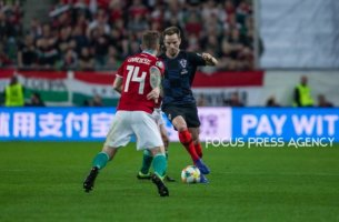 Dejan Lovren of Croatia competes for the ball with Gergo Lovrencsics of Hungary during the Hungary and Croatia European Qualifying match at Groupama stadium on March 24, 2019 in Budapest, Hungary.