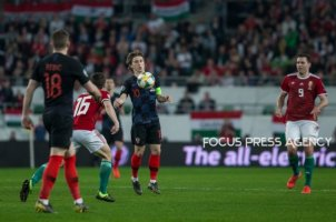 Luka Modric of Croatia competes for the ball with Mate Pátkai of Hungary during the Hungary and Croatia European Qualifying match at Groupama stadium on March 24, 2019 in Budapest, Hungary.