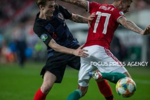 Dejan Lovren of Croatia competes for the ball with Roland Varga of Hungary during the Hungary and Croatia European Qualifying match at Groupama stadium on March 24, 2019 in Budapest, Hungary.