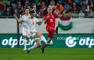 Mate Vida of Hungary competes for the ball with Richard Almeida of Azerbaijan during the Hungary and Azerbaijan European Qualifier match at Groupama stadium on Oct 13, 2019 in Budapest, Hungary.