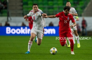Mate Vida of Hungary competes for the ball with Tamkin Khalilzade of Azerbaijan during the Hungary and Azerbaijan European Qualifier match at Groupama stadium on Oct 13, 2019 in Budapest, Hungary.