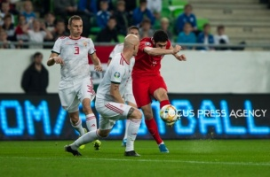 Ramil Sheydaev of Azerbaijan competes for the ball with Botond Baráth of Hungary during the Hungary and Azerbaijan European Qualifier match at Groupama stadium on Oct 13, 2019 in Budapest, Hungary.