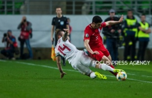 Gergo Lovrencsics of Hungary competes for the ball with Ramil Sheydaev of Azerbaijan during the Hungary and Azerbaijan European Qualifier match at Groupama stadium on Oct 13, 2019 in Budapest, Hungary.