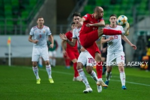 Pavlo Pashayev of Azerbaijan competes for the ball with Dominik Szoboszlai of Hungary during the Hungary and Azerbaijan European Qualifier match at Groupama stadium on Oct 13, 2019 in Budapest, Hungary.