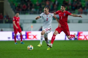 Mihaly Korhut of Hungary competes for the ball with Araz Abdullayev of Azerbaijan during the Hungary and Azerbaijan European Qualifier match at Groupama stadium on Oct 13, 2019 in Budapest, Hungary.