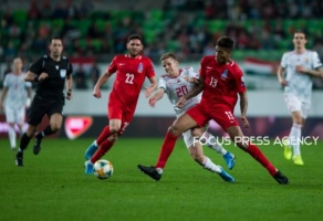 Istvan Kovács of Hungary competes for the ball with Eddy of Azerbaijan during the Hungary and Azerbaijan European Qualifier match at Groupama stadium on Oct 13, 2019 in Budapest, Hungary.
