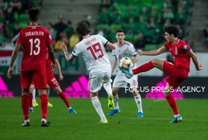Bahlul Mustafazade of Azerbaijan competes for the ball with David Holman of Hungary during the Hungary and Azerbaijan European Qualifier match at Groupama stadium on Oct 13, 2019 in Budapest, Hungary.